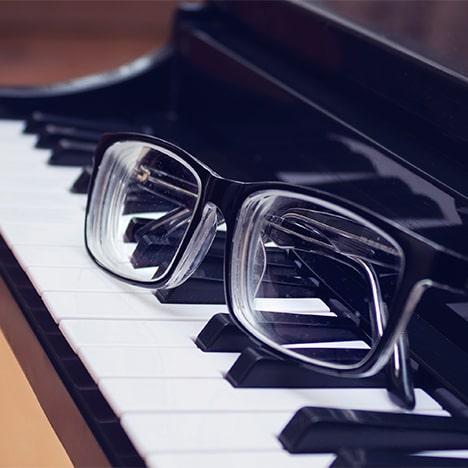 glasses on piano keys