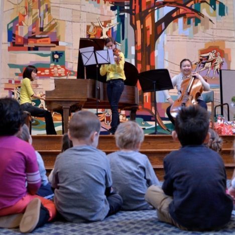 students watch musical performance