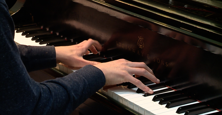 pianist hands on steinway and sons piano