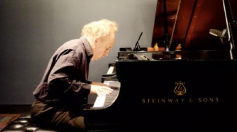 man playing piano at quarantine concert