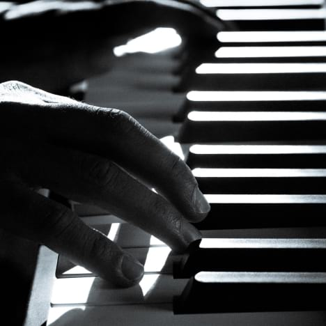 close-up of gentleman playing piano