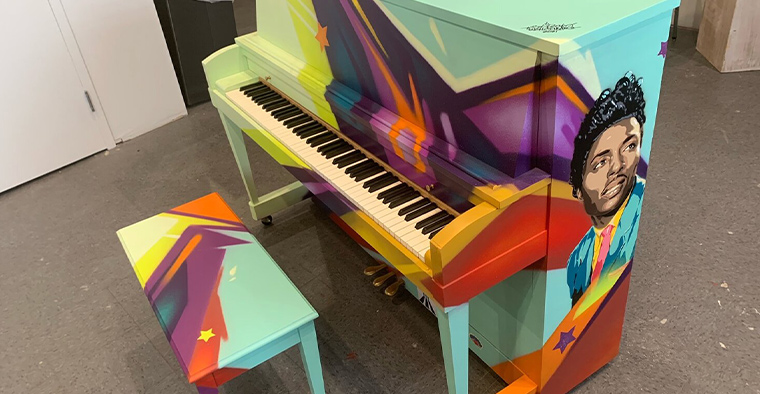 Graffiti HeArt's piano at the Rock and Roll Hall of Fame.