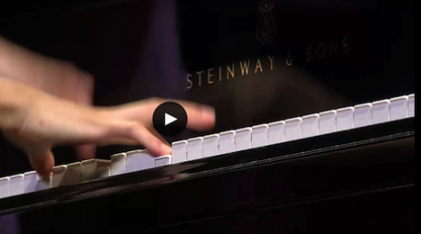 contestant playing the piano semi-final round session 1